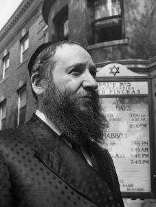 Rabbi Levi Horowitz was photographed in 1966 outside the New England Hasidic Center on Beacon Street in Brookline.