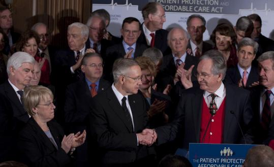 """We stand on the doorstep of history,'' said Senate majority leader Harry Reid (center), congratulated by Senator Tom Harkin."