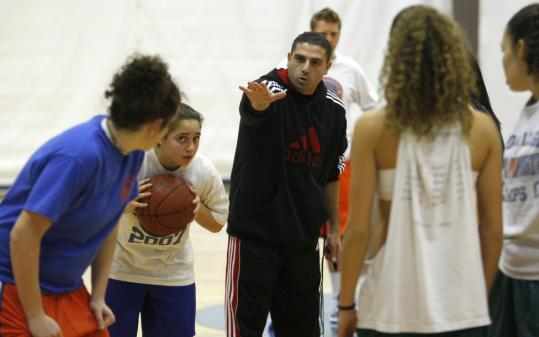 Sam Doner, head coach of Newton South girls' basketball team, directs a practice.