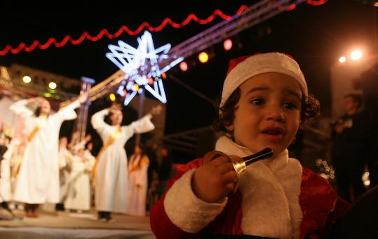 A girl attended Christmas Eve celebrations yesterday outside the Church of the Nativity in the West Bank city of Bethlehem. Residents, still recovering from years of violence, celebrated their town&#8217;s annual day in the spotlight along with tourists.