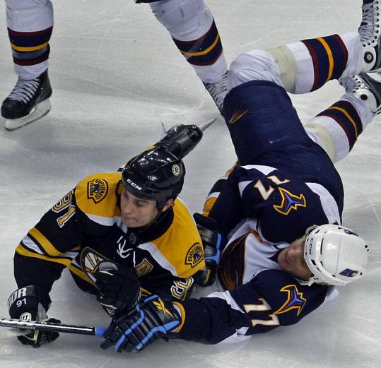 Marc Savard (left), who had three points in the game, battles Atlanta's Pavel Kubina Wednesday.