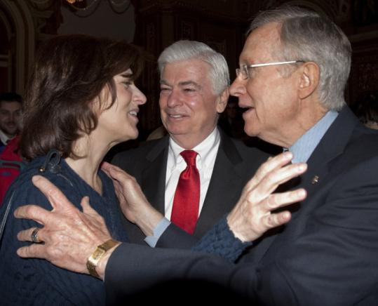 Victoria Reggie Kennedy, widow of the senator, hugged majority leader Harry Reid after the Senate vote yesterday.