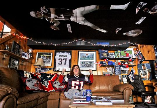 Christine Brennan, Patriots Fan of the Year, in her basement, surrounded by her collection of memorabilia.