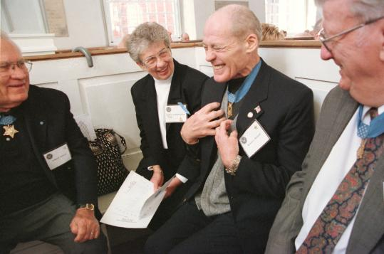 "In 2001, Robert L. Howard (second from right), recipient of the Congressional Medal of Honor, told war stories at the Old North Church in Boston. The medal citation credited him for his ""complete devotion to the welfare of his men at the risk of his life.''"