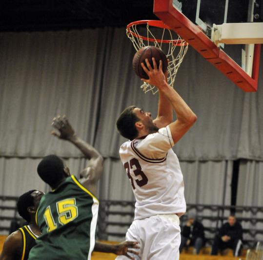 At 6 feet 8 inches, Bill Johnson gives MIT some bang on the boards, and he is looked to by his coach as a team leader.