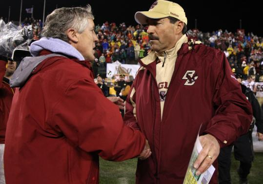 Southern Cal coach Pete Carroll shakes hands with Boston College head man Frank Spaziani, after Spaziani's Eagles hung with the Trojans for most of Saturday night's Emerald Bowl.