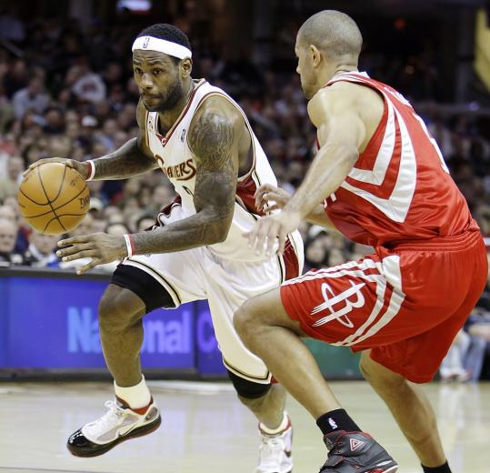 Shane Battier supplied the defensive pressure on this play, but LeBron James didn't have much trouble, scoring 29 against the Rockets.