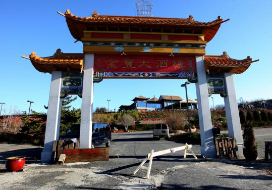 The entrance to the elaborate pagoda-style restaurant atop a hill in Saugus was blocked. Jin Asian Cuisine was closed this month by officials who cited unpaid taxes and liquor law violations.