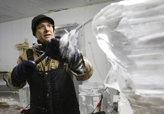 "Donald Chapelle works on an ice sculpture at his studio in Lawrence. He will be carving ""Michelangelo Sculpting David'' near the Park Street T station for First Night."