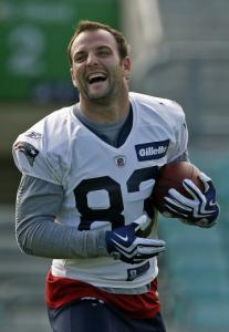 Wes Welker has reason to be cheery: He leads the NFL in catches and is a Pro Bowler.