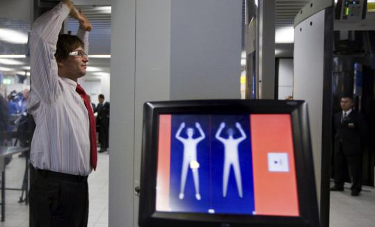 A full-body scanner is demonstrated Monday at Amsterdam's Schiphol Airport. New scanner software projects a stylized image.
