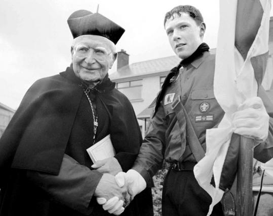 In 1995, Cardinal Daly greeted Protestant Boy Scout Simon Beckett, 15, before a Saint Patrick&#8217;s Day parade in Armagh, Northern Ireland, when Catholics and Protestants marched together.