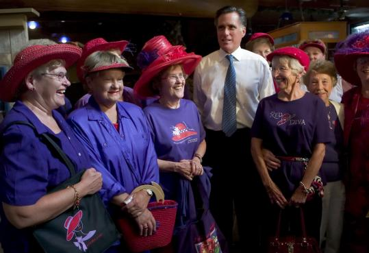While campaigning in Iowa, Mitt Romney met the Red Hat Divas of Hampton. He will return to Iowa, where he was second in the presidential caucus, to promote his second book.