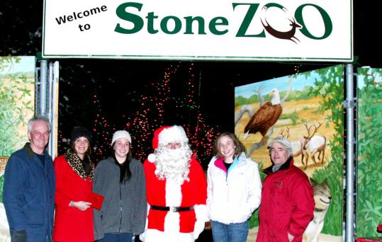 "Gerry McSweeney (from left), Wendy McSweeney, Becca McSweeney, Santa, Molly McSweeney, and John Linehan, general manager of the Stone Zoo. The McSweeney family came to visit Globe Santa with more than $450 and a story titled ""The Loose Change in the Laundry Fund.''"