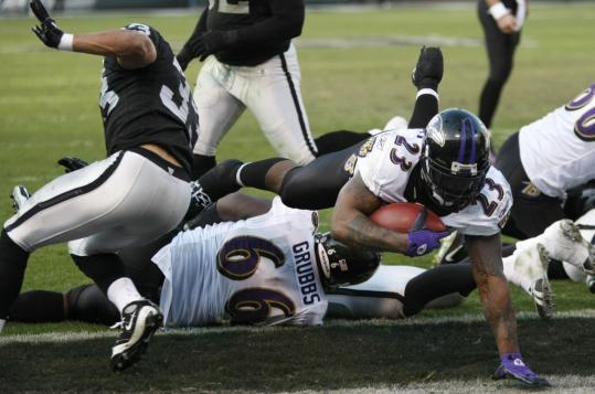 Baltimore's Willis McGahee dives for his third touchdown of the day, a fine complement to his career-high 167 yards rushing.