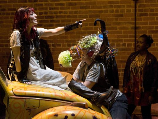 """Marianna Bassham as Titania and Robert Walsh as Bottom in the Actors' Shakespeare Project's """"A Midsummer Night's Dream.''"""