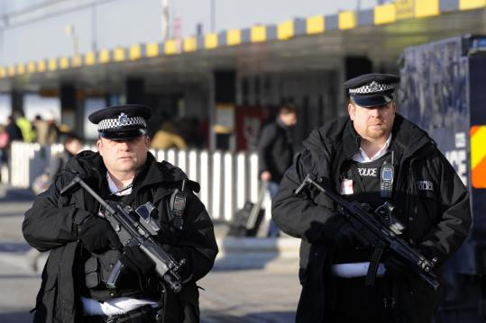 Armed police officers maintained a presence at London's Heathrow Airport Terminal 1 yesterday.