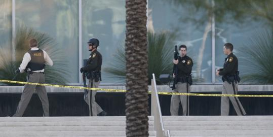 Law enforcement officers surrounded a federal courthouse in Las Vegas following yesterday's gun battle.