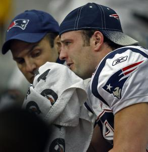Wes Welker appears despondent on the bench after injuring his left knee after making a first-quarter catch Sunday.