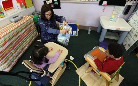 At Canton&#8217;s Rodman Center, a teacher works with children in The Education Cooperative, a special education program.
