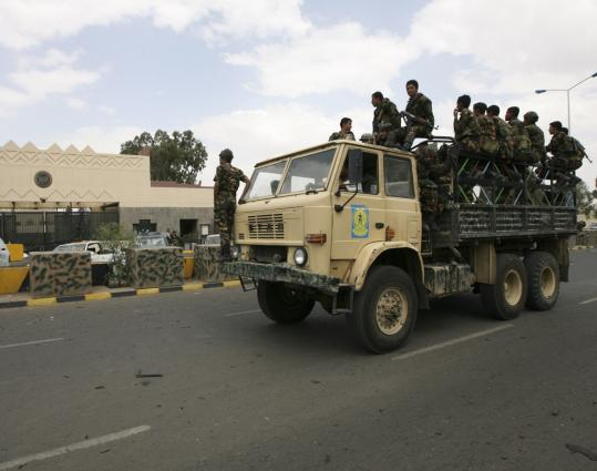 Yemeni soldiers patrolled a road near the US Embassy in Sana. The embassy reopened yesterday after a two-day closure, which was prompted by the threat of a possible Al Qaeda attack.