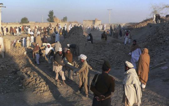 Pakistanis searched for bodies in the rubble after a suicide bombing in Shah Hasan Khel village last weekend. The villagers, who had tried to resist Taliban infiltration, mourned the victims of an apparent revenge attack that killed scores of civilians.