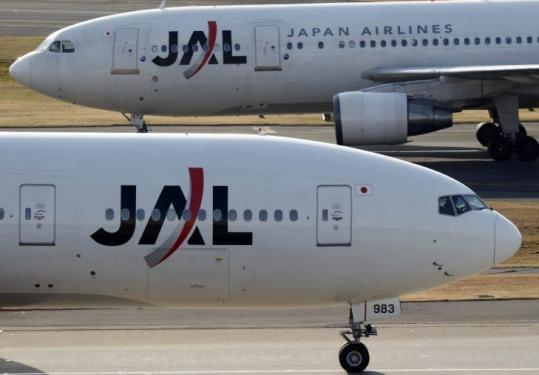 American and Delta both want to be Japan Airlines's partner. JAL lost $1.5 billion over the six months through September