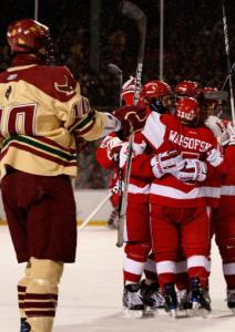 BC's Jimmy Hayes watches BU celebrate the only goal of the first, by David Warsofsky.