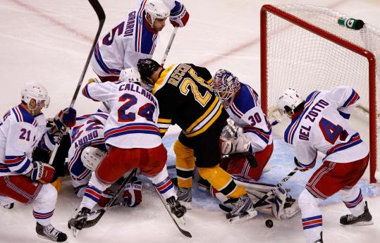 There were plenty of Rangers on hand to keep Mark Recchi and the Bruins from coming back during the third period.