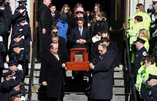The remains of Harold Brown Jr. were carried down the steps of St. John the Evangelist Roman Catholic Church yesterday.