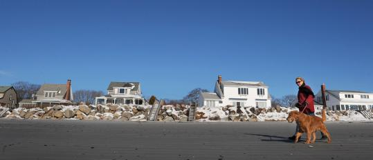 Sharon Eon, a resident, walked along Goose Rocks Beach in Kennebunkport, Maine.