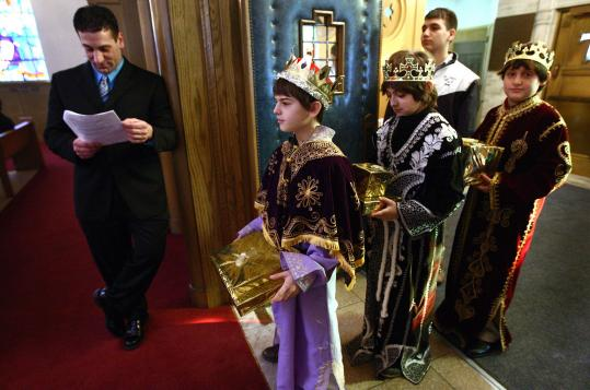 Brian Jakob, Nicholas Shervanian, and Alex DerVartanian, waited yesterday for their entrance into the sanctuary of Holy Trinity Armenian Church of Greater Boston. Fourth-grade teacher Edward Yessaian assisted the boys, dressed as the three kings.