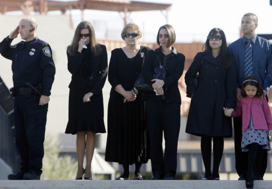 Mourners paid their respects yesterday to slain security officer Stanley Cooper as his funeral motorcade passed the Las Vegas courthouse in which he was killed.