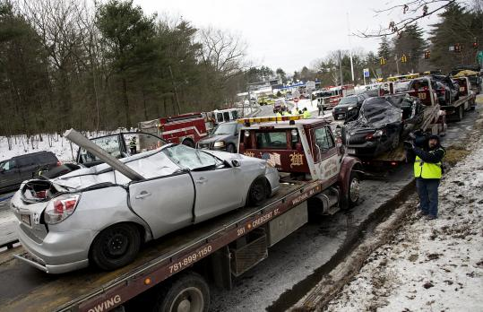 The three vehicles that were damaged by a tanker truck that rolled over on Route 2 in Lincoln were ready to be towed away yesterday. Just one of the drivers of these vehicles was hurt, and her injuries were minor.