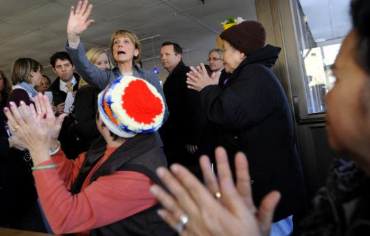 A crowd including many Vietnamese immigrants greeted Martha Coakley at an event in Dorchester yesterday. Scott Brown, meanwhile, visited a Chelmsford medical device plant.