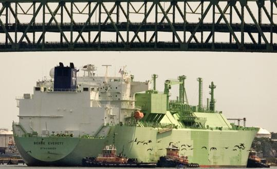 With Tobin Bridge traffic shutdown and a heavy escort on land and sea, an LNG tanker enters the Mystic River.