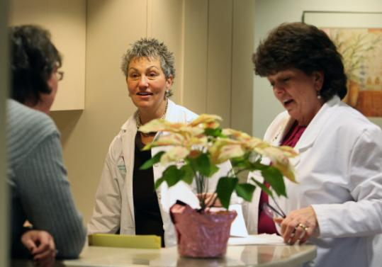 At Winchester Hospital, workers had pay restored. Kelley Nunnelley (left) conferred with nurses Cherry Frost and Christine Callahan this week.