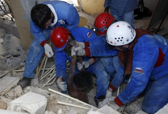 Russian rescuers freed Senvilo Ovri, 11, from rubble in Port-Au-Prince yesterday.