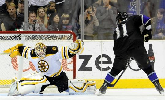 Bruins goalie Tim Thomas, who made 31 saves in regulation, can't close the pads in time to stop Anze Kopitar in the shootout, which the Kings won.