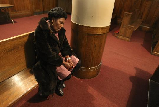 Vicroire Francilot Jean rocked from side to side at St. Angela Merici, mourning the presumed death of three of her six children.