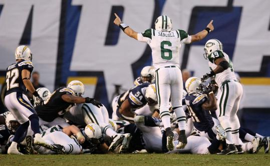 Quarterback Mark Sanchez has reason to jump for joy after the Jets converted the first down that enabled them to run out the clock.