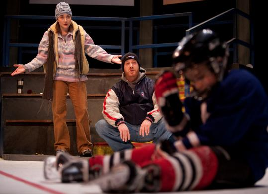"Danielle Perry and Gabriel Kuttner play the lovelorn parents of young hockey players in Stoneham Theatre's production of ""Hockey Mom, Hockey Dad.''"