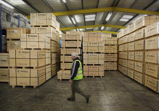 Water-sanitation equipment at an Oxfam warehouse in England was being prepared last weekend to be sent to Haiti. Oxfam America has raised $4.8 million in online donations for Haiti.