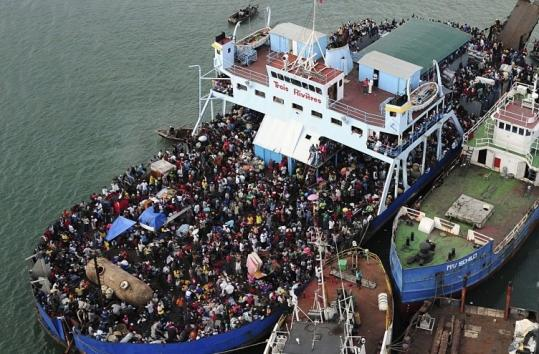 Haitians crowded a ship near Port-au-Prince. US officials said Haitians caught trying to escape by sea would be sent back.