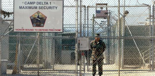 """Camp Delta guards told Harper's magazine that three detainees were taken to a """"black'' site shortly before their deaths in 2006."""