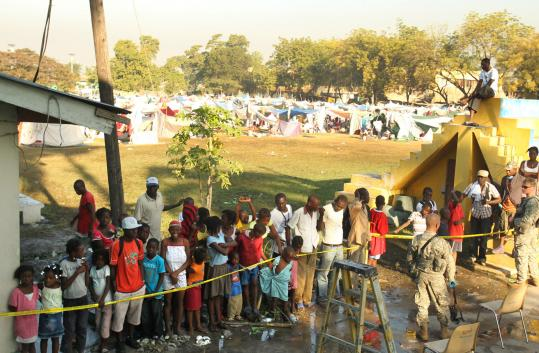 A Massachusetts disaster medical team set up a mobile hospital in Port-au-Prince as hundreds of people waited for medical treatment.