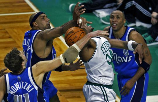 The Celtics' Paul Pierce didn't lose his head when surrounded by Mavericks, but he lost the ball.