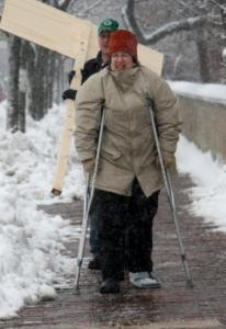 Beth Rich is not deterred by a broken ankle, crutches and snow, as she heads to Town Hall in Medford yesterday to vote for Martha Coakley.