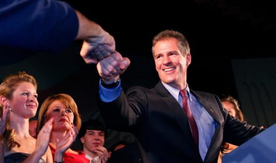 Scott Brown bumped fists with Doug Flutie, a high-profile backer who provided live music for the Republican's gala.