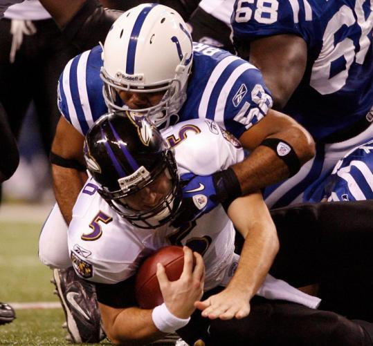 Gary Brackett's second-quarter sack of Joe Flacco helped spark a 14-point Colts outburst, leading to a 17-3 halftime lead.